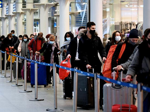 People at St Pancras station in London, wait to board the last train to Paris today, Sunday Dec. 20, 2020.