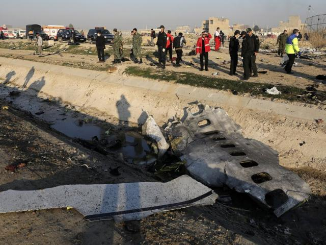 In this Jan. 8, 2020, photo, debris is seen from an Ukrainian plane which crashed as authorities work at the scene in Shahedshahr, southwest of the capital Tehran, Iran. (AP Photo/Ebrahim Noroozi, File)