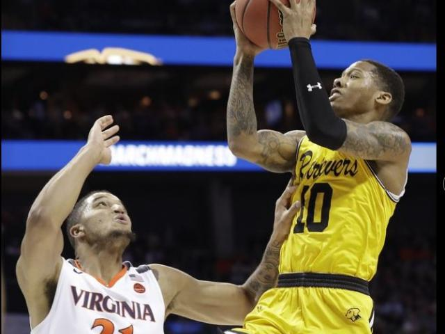 UMBC's Jarius Lyles (10) shoots over Virginia's Isaiah Wilkins (21) during the second half of a first-round game in the NCAA men's college basketball tournament.