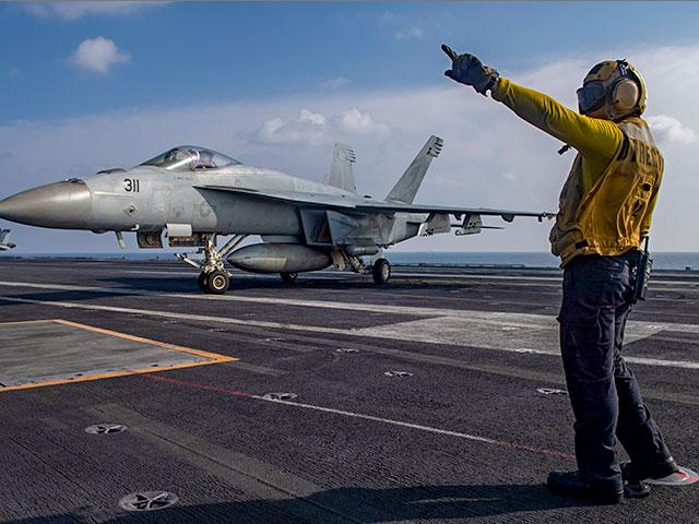 Aviation Boatswain's Mate 3rd Class Marnell Maglasang directs an F/A-18E Super Hornet on the aircraft carrier USS Nimitz in the Arabian Sea, Nov. 27, 2020. (Mass Communication Specialist 3rd Class Cheyenne Geletka/U.S. Navy via AP)