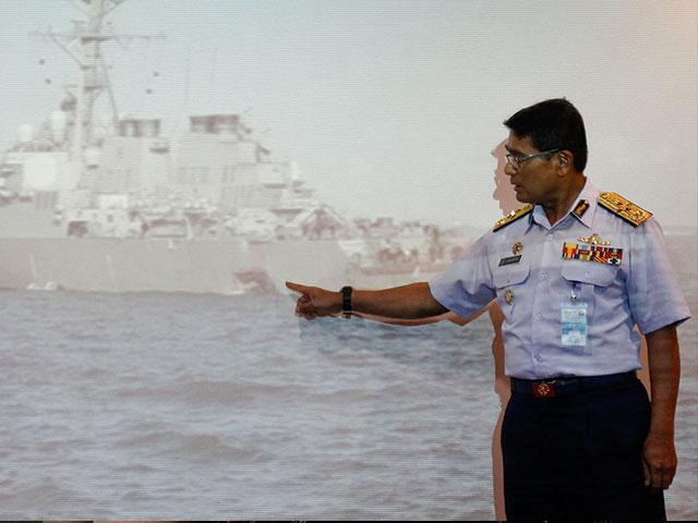 Malaysian Maritime Director Indera Abu Bakar points the damage of USS John S. McCain, Photo, AP, Daniel Chan