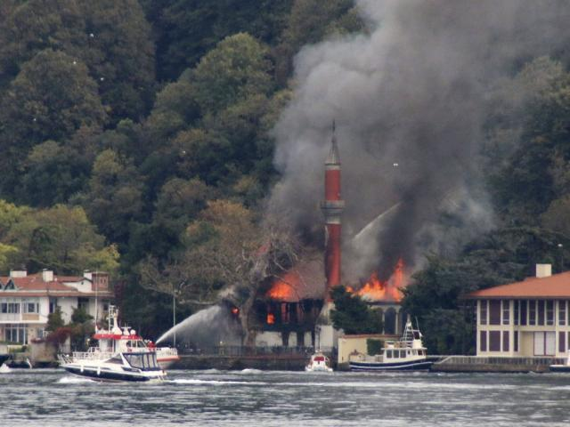 A fire engulfs Vanikoy Mosque, a historic wooden mosque, in Istanbul, Sunday, Nov. 15, 2020 (DHA via AP)