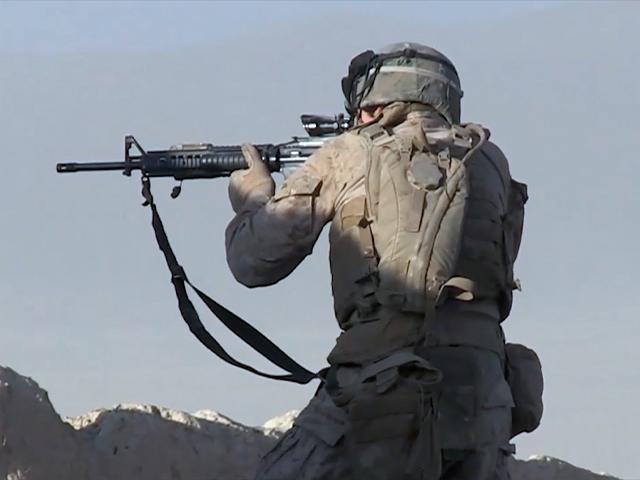 Soldier firing rifle
