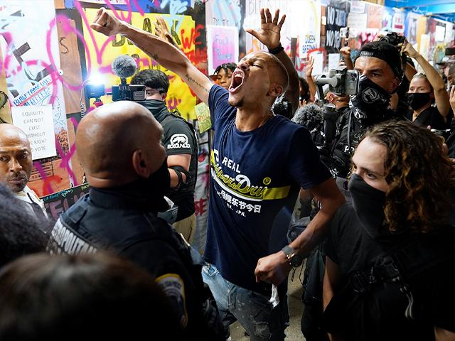 Anti-Trump protesters rally along 16th Street, Northwest, renamed Black Lives Matter Plaza, Aug. 27, 2020, in Washington. (AP Photo/Julio Cortez)