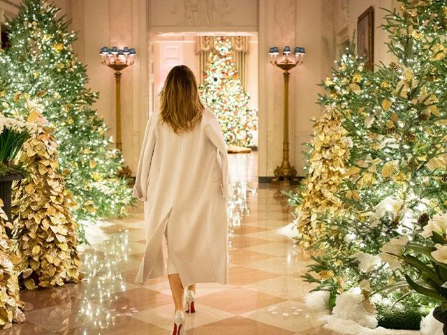 First Lady Melania Trump reviews the Christmas decorations Sunday, Dec. 1, 2019, in the Cross Hall of the White House. (Official White House Photo by Andrea Hanks)