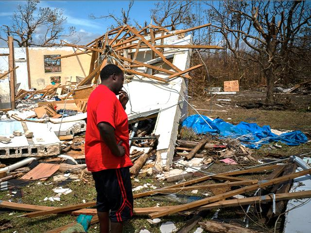 A man cries after discovering his shattered house and not knowing if his 8 relatives who lived in the house, survived Hurricane Dorian on Grand Bahama island (AP Photo/Ramon Espinosa)