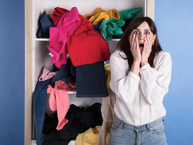 woman shocked at messy bedroom