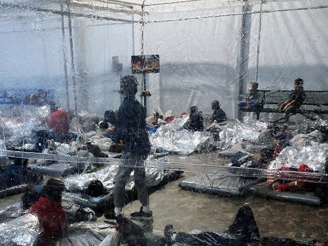 Detainees in a Customs and Border Protection (CBP) temporary overflow facility in Donna, Texas. (Photo courtesy of the Office of Rep. Henry Cuellar via AP)