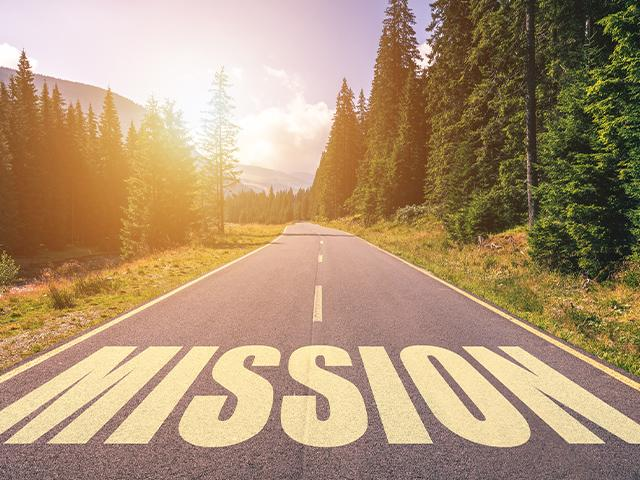 the word mission written across an open road ahead