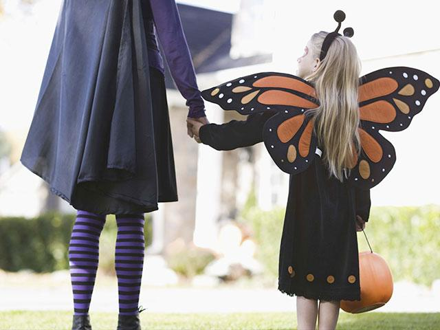 Mom and daugther in Halloween costumes