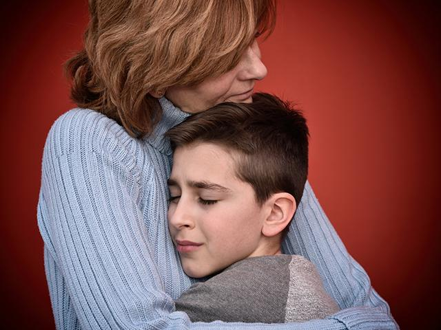 mother-hug-son_si.jpg