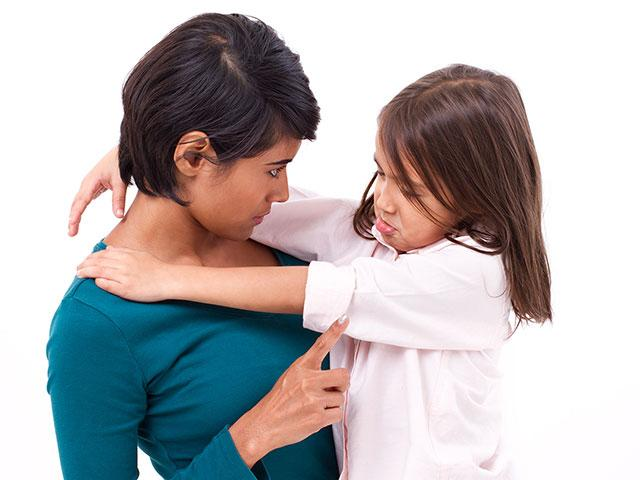Mother disciplining daughter