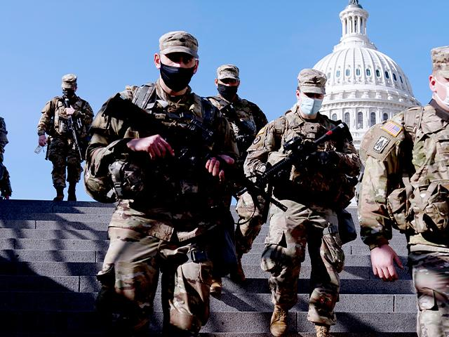 Members of the National Guard walk past the Dome of the Capitol Building on Capitol Hill in Washington, Jan. 14, 2021. (AP Photo/Andrew Harnik)