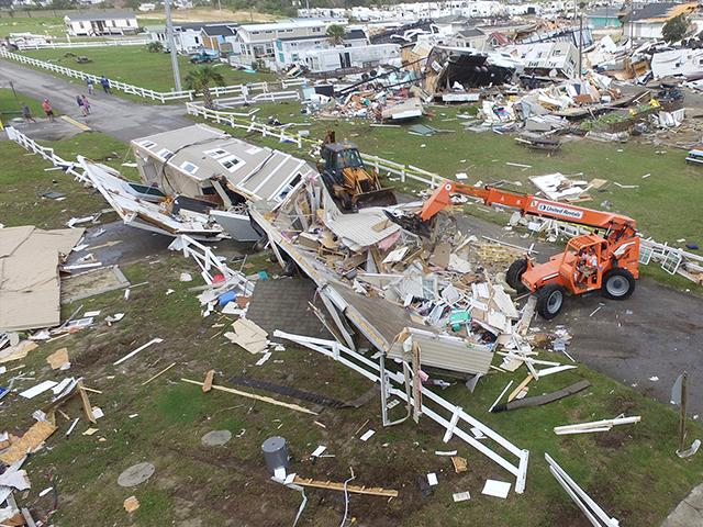 Emerald Isle town employees work to clear the road after a tornado hit Emerald Isle N.C. as Hurricane Dorian moved up the East coast on Thursday, Sept. 5, 2019. (AP Photo/Tom Copeland)