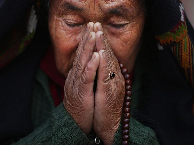 Nepal Woman Praying
