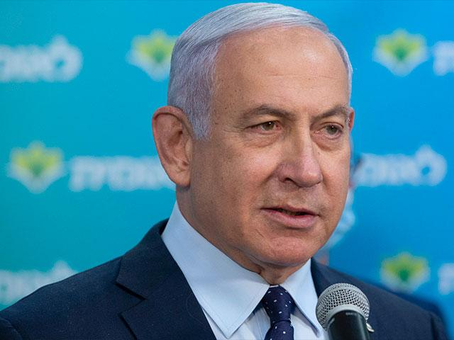 In this Feb. 16, 2021 file photo, Israeli Prime Minister Benjamin Netanyahu visits the Leumit Health Care Services vaccination facility in Jerusalem. (Alex Kolomoisky/Pool via AP, File)