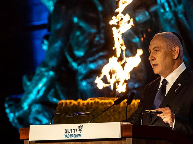 Israeli Prime Minister Benjamin Netanyahu delivers a speech during the opening ceremony of the Holocaust Martyrs and Heroes Remembrance Day at Yad Vashem Holocaust Museum in Jerusalem, on Wednesday, April 7, 2021. (Heidi Levine/Pool Photo via AP)
