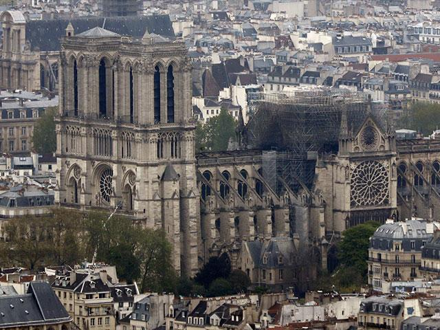 Notre Dame Cathedral Devastated, but Despite the Inferno, Prayers Rise and the Cross Remains