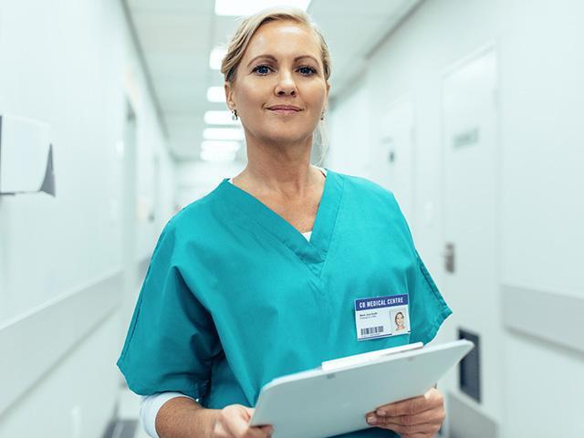 female nurse at hospital wearing scrubs