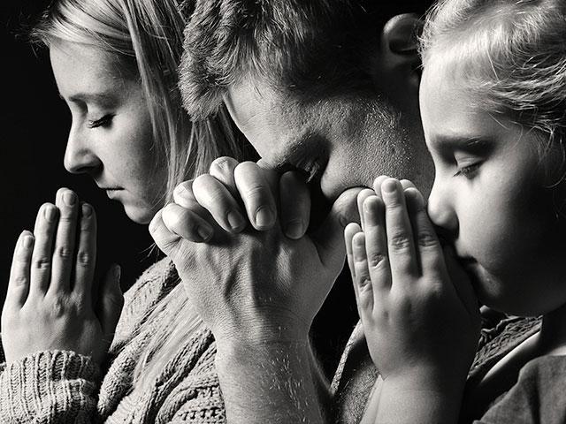 Praying family