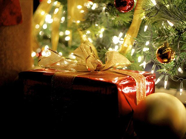 present under christmas tree - Christmas Devotional Stories