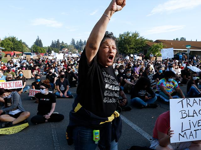 "A protester shouts the name ""George Floyd!"" during a demonstration in Sacramento, Calif.  (AP Photo/Rich Pedroncelli)"