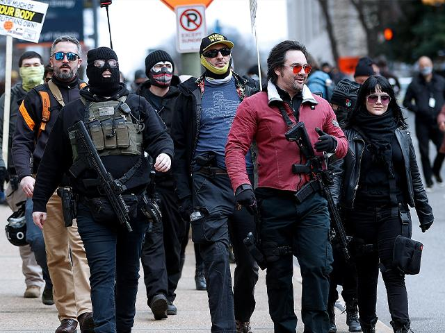 Gun rights supporters walk down Ninth Street in Richmond, Va., on Lobby Day Monday, Jan. 18, 2020. (Alexa Welch Edlund/Richmond Times-Dispatch via AP)