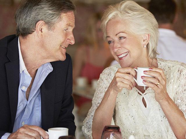 Senior couple drinking coffee