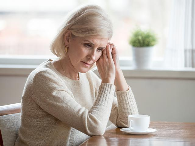 senior woman having coffee alone