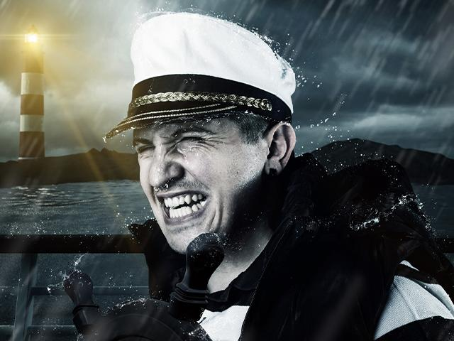 ship at night with captain steering the boat