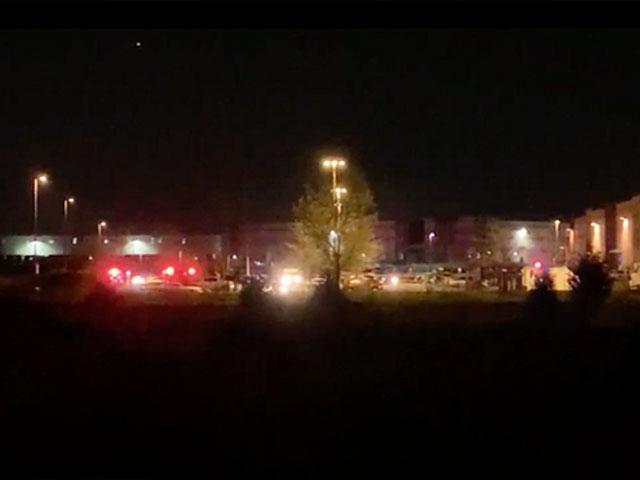At least 8 people are dead following a mass shooting at an Indianapolis FedEx facility. 16 April, 2021. (WRTV via AP)
