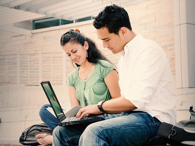 studentsstudyinglaptopcomputeras