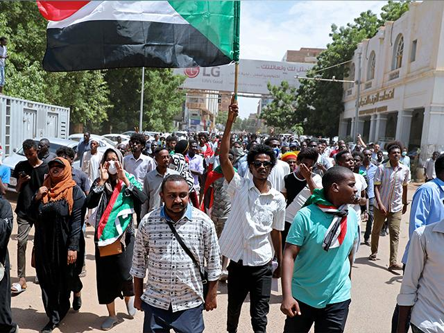 Sudanese protesters rally outside the Cabinet's headquarters in the capital, Khartoum, Sudan, Monday, Aug. 17, 2020. (AP Photo/Marwan Ali)