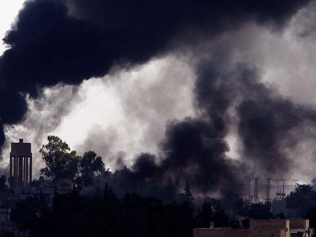 Smoke billows from targets inside Syria during bombardment by Turkish forces Thursday, Oct. 10, 2019. (AP Photo/Lefteris Pitarakis)