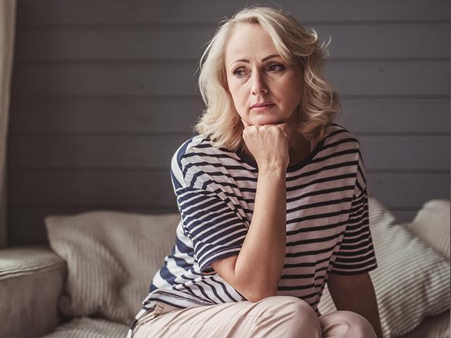 Unhappy mature woman