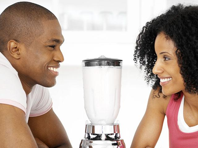 young couple with blender