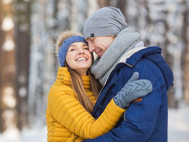 young couple embracing outside in winter