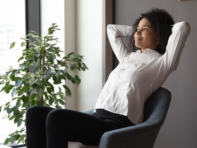 woman looking hopeful sitting in an office chair