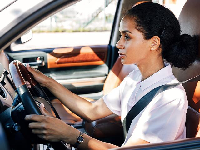 tired woman driving