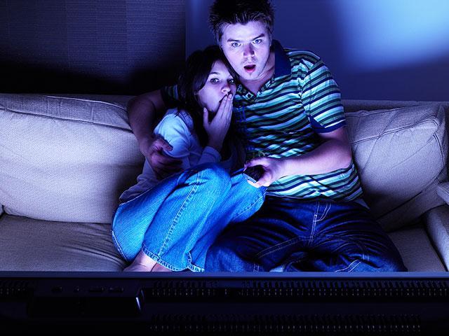 woman-watching-horror-movie