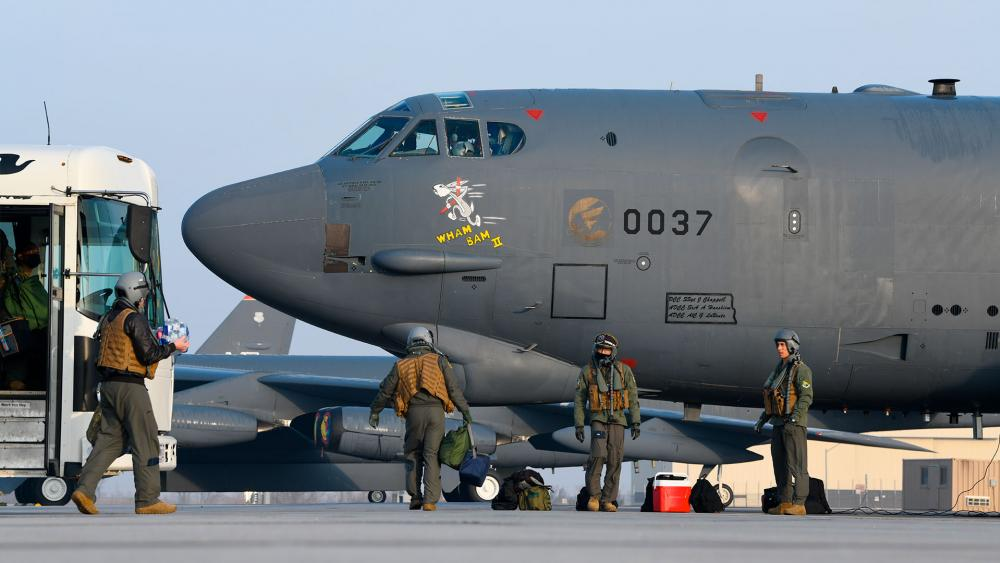 """Pilots board B-52H Stratofortress bomber """"Wham Bam II"""" before a flight over the Mideast on March 6, 2021. (U.S. Air Force/Senior Airman Josh W. Strickland via AP)"""