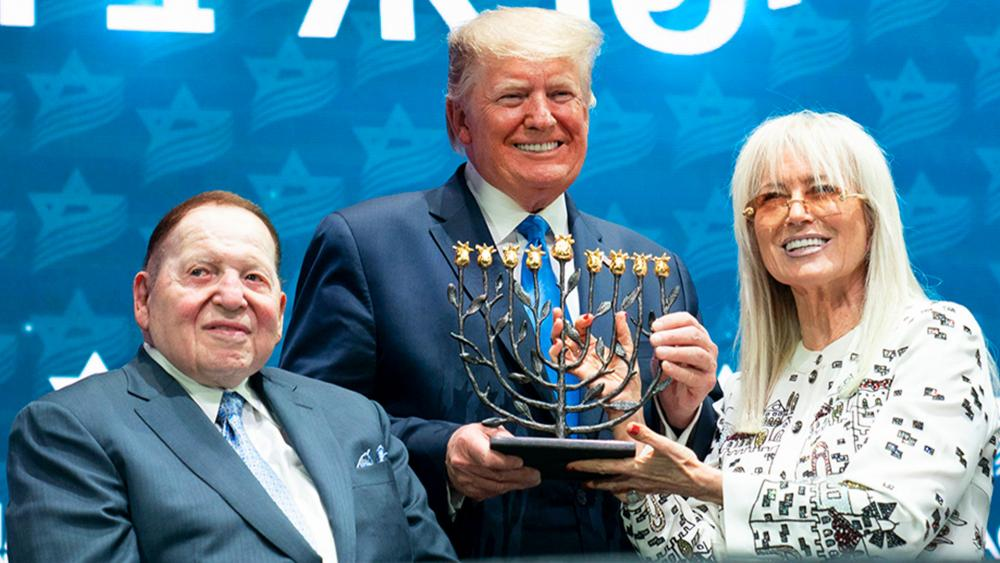 President Donald J. Trump receives a menorah from Miriam and Sheldon Adelson at the Israeli American Council National Summit Saturday, Dec. 7, 2019, in Hollywood, FL (Official White House Photo by Joyce N. Boghosian)