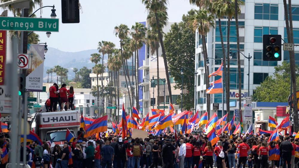 Armemian-Americans hold a rally protesting against the Armenian genocide in Beverly Hills, Calif., Saturday, April 24, 2021. (AP Photo/Damian Dovarganes)