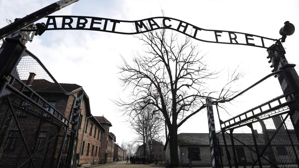 In this Friday, Feb. 15, 2019 file photo an entrance gate at the Nazi concentration camp Auschwitz-Birkenau is pictured in Oswiecim, Poland.