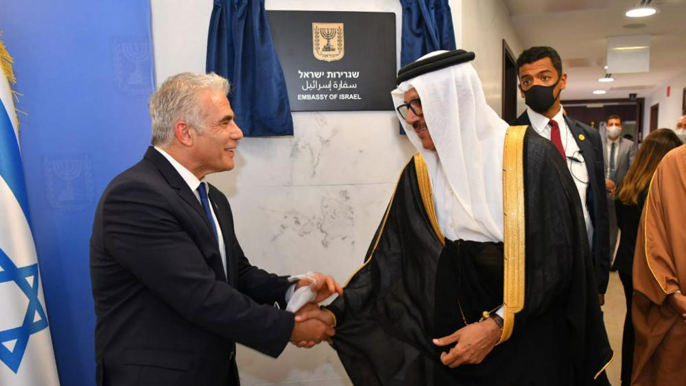 Foreign Minister Yair Lapid and Bahrain's Foreign Minister Abdullatif al Zayani Open Israel's Embassy in Manama. Photo Credit: Shlomi Amshalem, GPO.