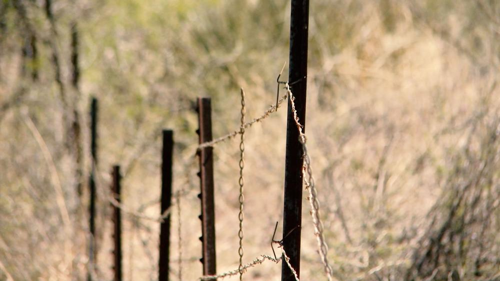 Camo AK47s and Ranches Overrun Why a Barbed Wire Border Fence Isn