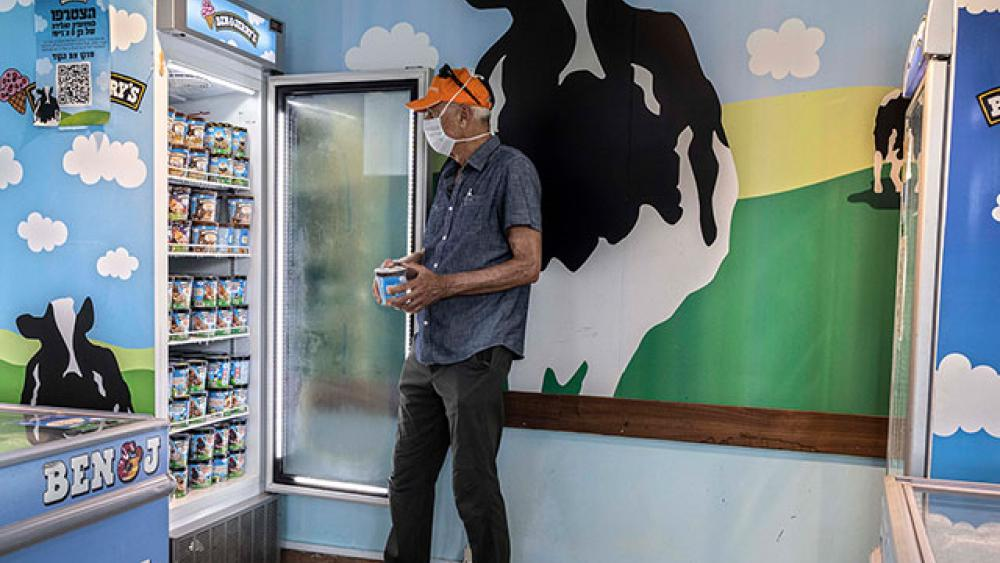 An Israeli shops at the Ben & Jerry's ice-cream factory in the Be'er Tuvia Industrial area, Tuesday, July 20, 2021.