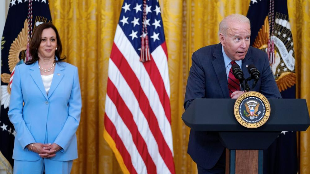 President Joe Biden whispers into the mic in the East Room of the White House, June 24, 2021, in Washington. (AP Photo/Evan Vucci)