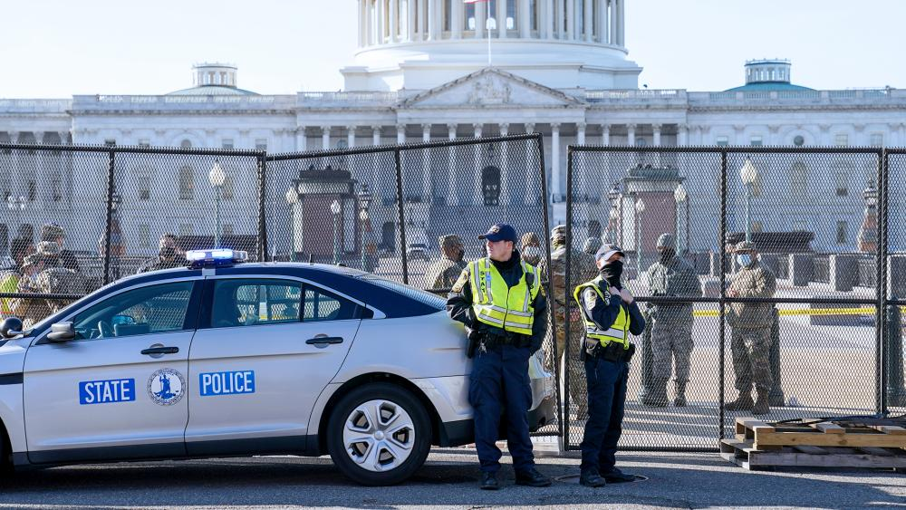 Fencing is placed around the exterior of the Capitol grounds, Jan. 7, 2021 after rioters stormed the Capitol. (AP Photo/John Minchillo)
