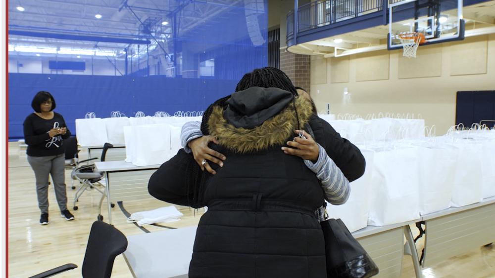Furloughed federal worker embraced by volunteer at First Baptist Church of Glenarden (Photo: CBN News)
